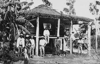 South Sea Islanders standing in front of a house in Mackay in 1907
