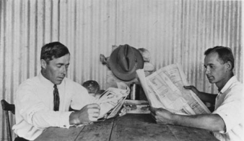 Cane farmers reading newspapers Tully ca. 1929